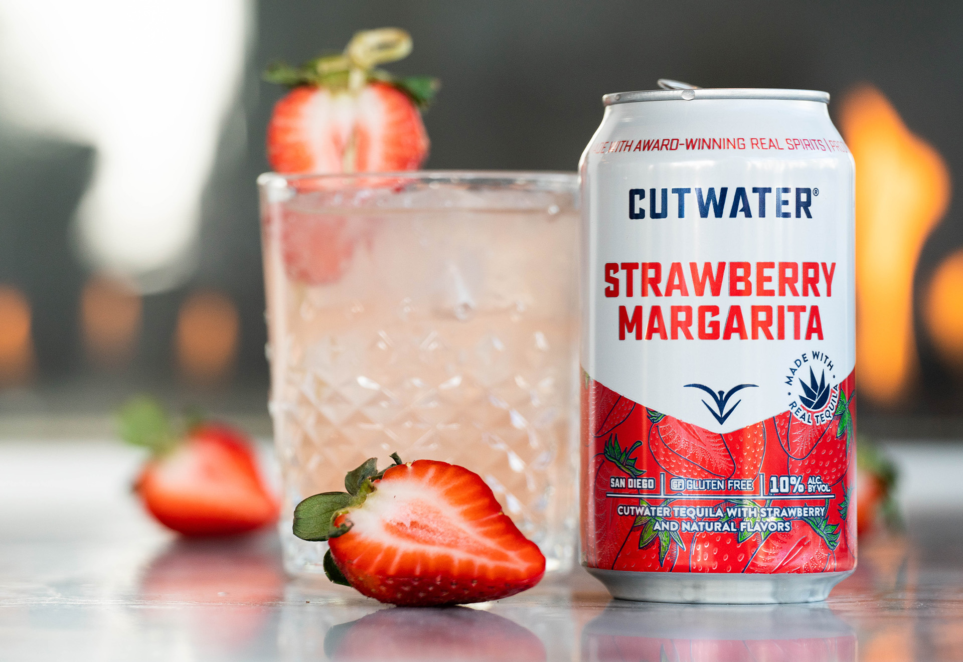 Cutwater Strawberry Margarita can with cocktail